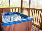 Relax in the private hot tub.