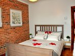 Bedroom 2. Queen size bed, super comfy mattress.