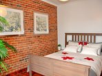 Bedroom 2: Queen-size bed. The original brick walls date of 1870 and give a...
