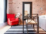 Authentic brick wall gives warmth and character to this aptmt