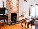 The charm of 1870 original bricks and hardwood floors. The fireplace can not...