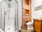 Bath and Shower. Pure lines, warm and natural materials (brick, wood, slate).