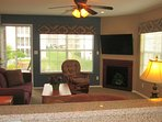 Rent a Branson condo. Relax in your own living room. 50 inch TV. Door opened to screened porch.