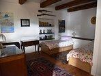 Bedroom on mezzanine floor, 2 single beds with en-suite bathroom.