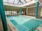 Indoor community pool with seating