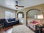 Den with double doors that open up to a queen sleeper sofa, chair and desk