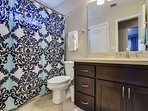 Guest bathroom upstairs features single sink and tub/shower combo