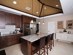 Enjoy the wine fridge, large island and very well equipped kitchen