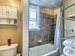 Rinse off in the shower/tub combo of this bathroom.