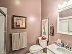 Soothing pink walls greet you in this bathroom.