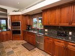 Gourmet kitchen with high end appliances , stocked with spices & oils