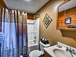 Utilize the shower/tub combo found in the first bathroom.