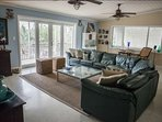 Large leather sectional located in the 2nd floor living room able to comfortably seat all of your family and friends.