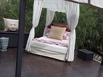 relaxing bed on sunny balcony