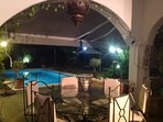 Terrace and pool at night