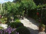 Top garden with gate to mountain walks
