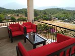 Relax in style on the first floor balcony.