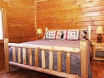 The master bedroom has a comfy king sized bed in the large room.