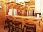 The bar looking into the full kitchen is a natural gathering place