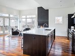 You'll have plenty of space for prep work at the oversized kitchen island, which also houses a dishwasher.