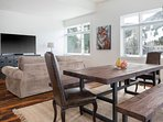 The hearty farm-style dining table seats up to 8 guests.