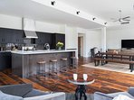 The open floor plan comprises the sitting area, kitchen, dining room, and living area.