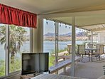 Watch TV or simply bask in the view of the lake.