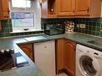 Includes washing machine, microwave, oven, hob and freezer in the hall cupboard.