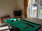 Games room with 6 foot pool table and Wii