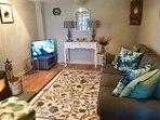 Cosy Living Room with Freesat TV & wood burner