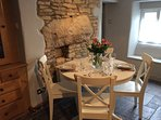 Dining next to exposed stone wall