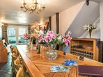 Dining room, log burner and frenchdoors to upper terrace and gardens