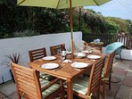 Dine in your private enclosed patio. You can see the sea from here too.