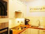 Kitchen has eye level oven as well as a combination microwave.
