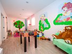 Playroom fully equipped with a lot toys, table soccer, play console, 1st floor
