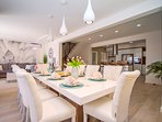Dining and living area with exit to outdoor dining area and pool area