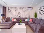 Lovely decorated and spacious living area with exit to pool area