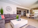 Fully equipped kitchen, living and dining area with A/C, Wi-Fi and TV