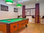 Billiards and gym at lower ground floor, garage level