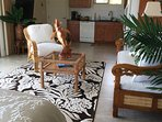 Gorgeous artwork, rugs, and carvings add to the tropical feel of this fifth bedroom and ohana suite