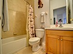 Guest bathroom with shower / tub combination.