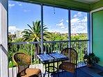 Screened patio has bright views