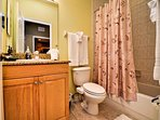 Full bathroom with tub and shower combination.
