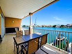 Balcony table has seating for 6 guests, great place for dolphin watching.