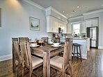 Dining table has seating for 6 guests.