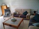 Salón, sofás de 3 y 2 plazas, y sillón individual