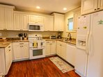 The kitchen has a double oven, microwave, refrigerator, dishwasher, toaster oven, garbage disposal and blender.