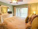 The master bedroom has sliding door access to the back porch.