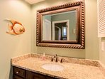 The vanity has plenty of counter space and cabinet area to store your bathroom items.