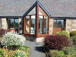 Begrum cottage has a south facing conservatory which overlooks the cottage garden.